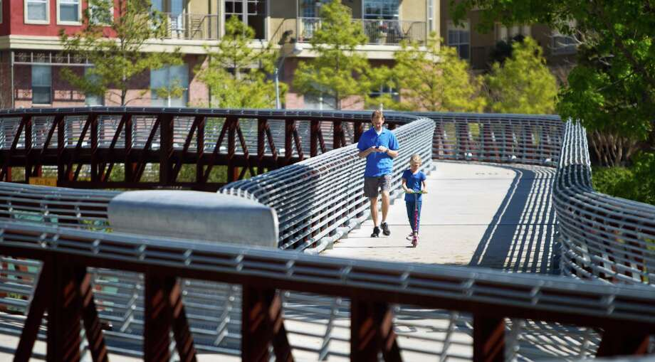 Chris Nault and his 7-year-old daughter, Elise, had perfect weather Friday for a stroll over Buffalo Bayou near Memorial and Montrose. Greater Houston has rebounded from last year's drought, but needs rain. Photo: Nick De La Torre, Staff / © 2013 Houston Chronicle