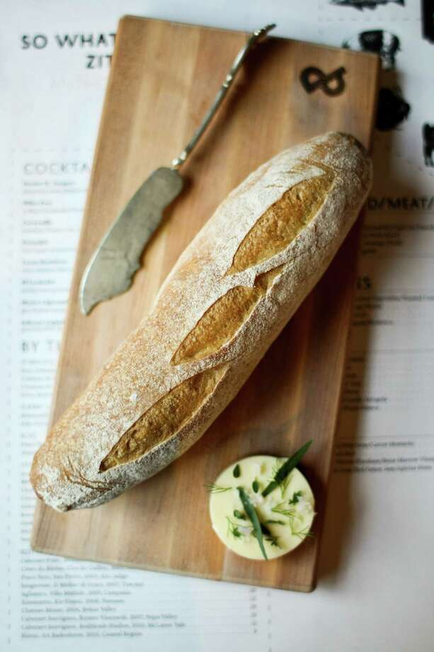 It might be possible that the good people of France can survive solely on wine, cheese, and their fabulous breads, including the legendary baguette. Photo: Nick De La Torre, Houston Chronicle / © 2012  Houston Chronicle