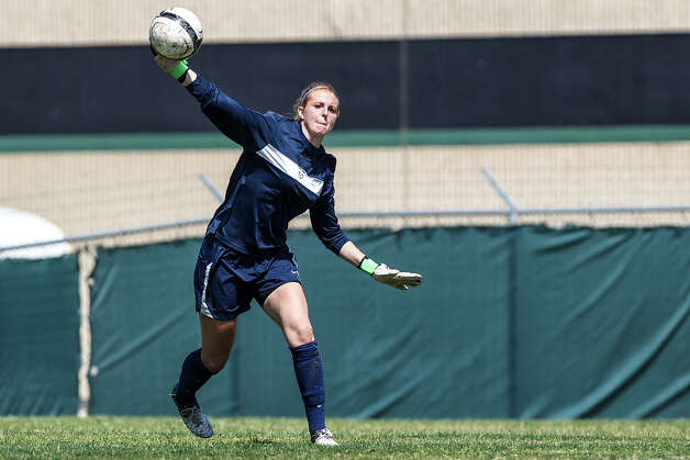 Johnson goalie Morgan Stearns clears the ball downfield during the second half of their District 26-5A girls soccer game at Blossom Athletic Center on Friday, March 15, 2013. Neither team was able to score and the game ended in a 0-0 tie.   MARVIN PFEIFFER/ mpfeiffer@express-news.net Photo: MARVIN PFEIFFER, Express-News / Express-News 2013