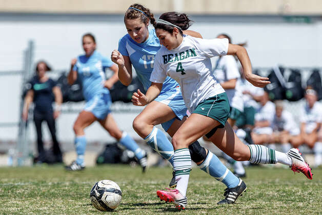 Reagan's Gaby Lio (right) tries to drive the ball past Johnson's Alyssa Clark during the second half of their District 26-5A girls soccer game at Blossom Athletic Center on Friday, March 15, 2013. Neither team was able to score and the game ended in a 0-0 tie.   MARVIN PFEIFFER/ mpfeiffer@express-news.net Photo: MARVIN PFEIFFER, Express-News / Express-News 2013