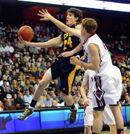 Weston's #24 Charlie DiPasquale lays up the ball, during Class M boys basketball final action against Valley Regional at the Mohegan Sun Arena in Uncasville, Conn. on Friday March 15, 2013. Photo: Christian Abraham / Connecticut Post