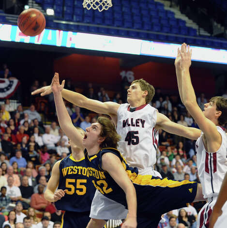 Weston's #42 Grant Limone misses a lay up attempt as he is pressured by Valey Regional's #45 Chris Polo, during Class M boys basketball final action at the Mohegan Sun Arena in Uncasville, Conn. on Friday March 15, 2013. Photo: Christian Abraham / Connecticut Post
