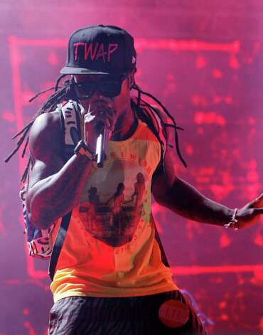 Lil Wayne performs during the Bonnaroo Music and Arts Festival in Manchester, Tenn., early Saturday, June 11, 2011. Photo: Dave Martin, AP / AP