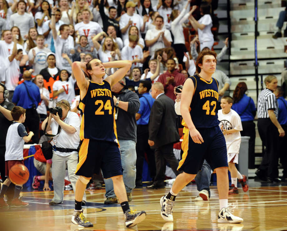 Weston's #24 Charlie DiPasquale, left, and #42 Grant Limone walk off the court after the the team was beat by Valley Regonal in Class M boys basketball final action at the Mohegan Sun Arena in Uncasville, Conn. on Friday March 15, 2013. Photo: Christian Abraham / Connecticut Post