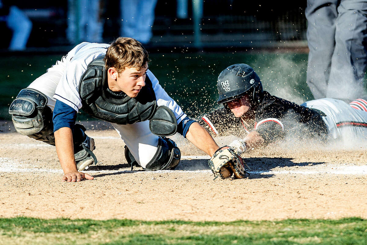 Churchill's Reed Hauser slides into home plate with the go-ahead run before O'Connor catcher Justin Garcia can apply the tag Friday at Wolff Stadium.