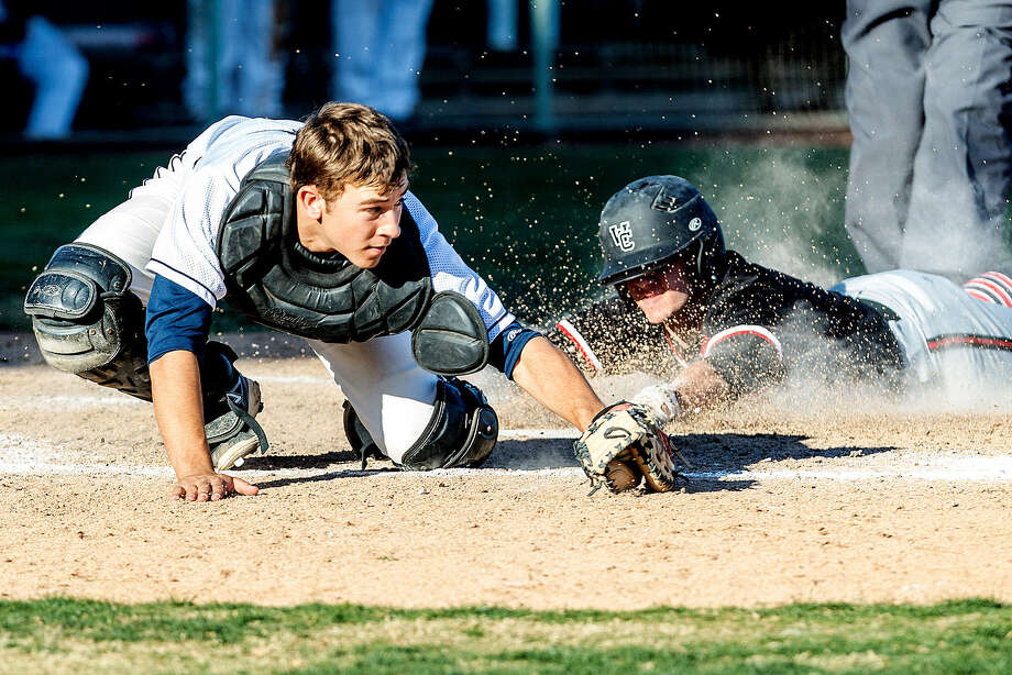 Churchill's Reed Hauser slides into home plate with the go-ahead run before O'Connor catcher Justin Garcia can apply the tag Friday at Wolff Stadium. Photo: Marvin Pfeiffer / San Antonio Express-News