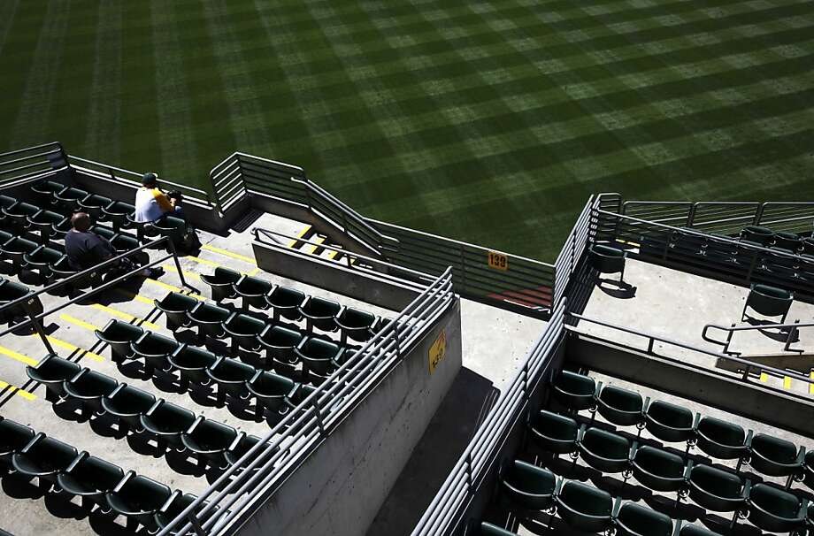 MLB wants fans to pay to move to a better seat - something A's fans could easily do for free last spring. Photo: Sarah Rice, Special To The Chronicle