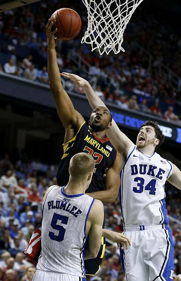 Maryland's Dez Wells scores two of his career-high 30 points against Duke's Mason Plumlee (who led the Blue Devils with 19 points) and Ryan Kelly. Photo: Ethan Hyman, McClatchy-Tribune News Service