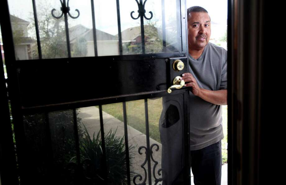 Charles Babineaux installed steel doors to protect his home. Now his subdivision says they're an eyesore and have to go. Photo: Mayra Beltran, Staff / © 2013 Houston Chronicle