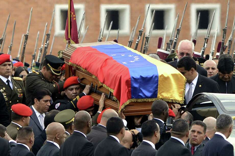 The casket containing the remains of Venezuelan President Hugo Chávez is taken to the museum where the leftist leader's body will be displayed indefinitely. Photo: Leo Ramirez / AFP / Getty Images