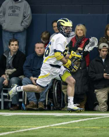 Greenwich native Sean Sutton carries the ball for Michigan. Photo: Martin Vloet, Martin Vloet/University Of Michi / Copyright 2013, © Michigan Photography. ALL RIGHTS RESERVED.  (734) 764-9217. photography.umich.edu