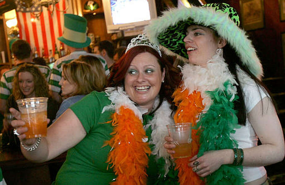 U.S.: Clearly the orange-and-green feather boa wasn't traditional enough, so these Irish lasses in San Francisco remembered to bring an authentic Celtic tiara and green-spotted pimp hat.