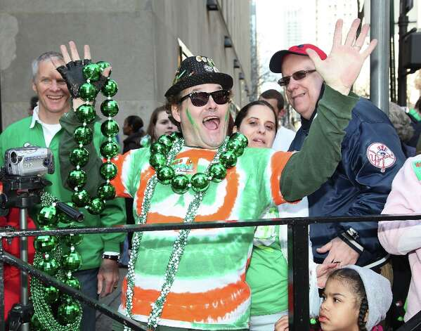 U.S.: Who knew that St. Patrick had been a fan in the fifth century of what would later be called Mardi Gras beads? Apparently this guy in New York knew. Hey, throw me something, O'Shaughnessy! Photo: Paul Zimmerman, Getty Images / 2012 Paul Zimmerman