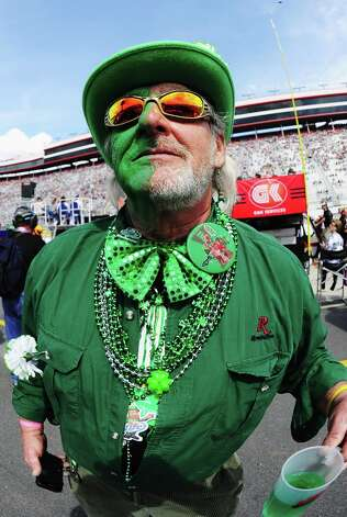 U.S.: A fan in Bristol, Tenn., celebrates the ancient Celtic tradition of NASCAR in customary garb on St. Patrick's. (Or maybe he though the holiday was for Danica Patrick.) Photo: John Harrelson, Getty Images For NASCAR / 2012 Getty Images