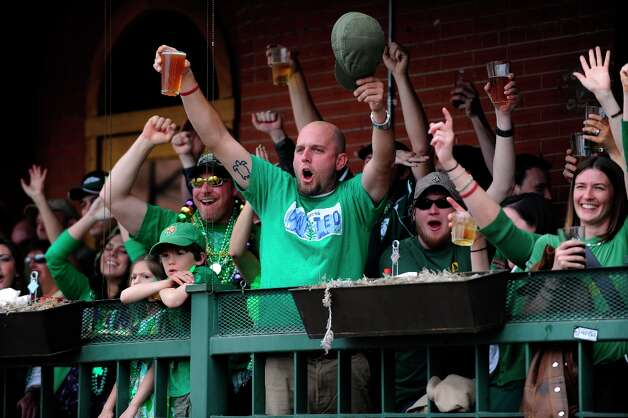 U.S.: The world's tallest leprechaun leads a cheer at the Wynkoop Brewing Company in Denver because, apparently, these people just realized they're at a brewery. Photo: Andy Cross, Denver Post Via Getty Images / Denver Post