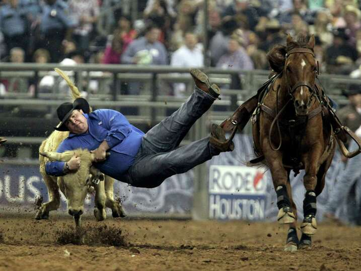 Straws Milan competes during the Steer Wrestling event at RodeoHouston in Reliant Stadium Friday, Ma
