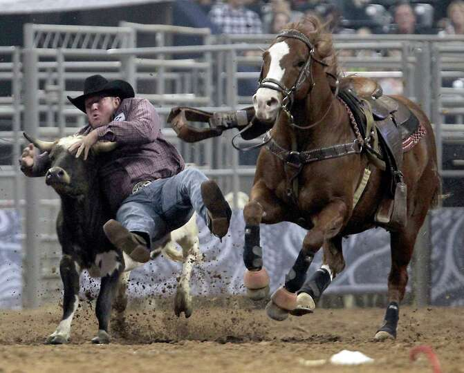 Tom Lewis competes during the Steer Wrestling event at RodeoHouston in Reliant Stadium Friday, March