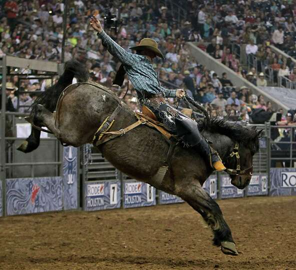 Tyler Corrington competes during the Saddle Bronc Riding event at RodeoHouston in Reliant Stadium Fr