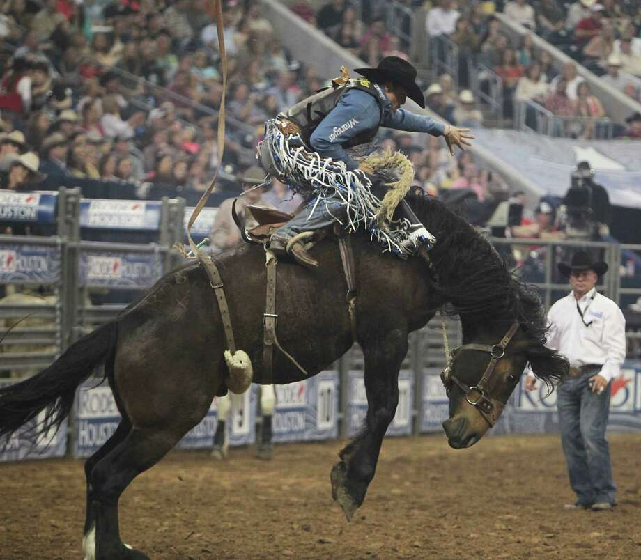 Jesse Wright competes during the Saddle Bronc Riding event at RodeoHouston in Reliant Stadium Friday, March 15, 2013, in Houston. Photo: James Nielsen, Houston Chronicle / © 2013  Houston Chronicle