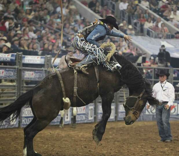 Jesse Wright competes during the Saddle Bronc Riding event at RodeoHouston in Reliant Stadium Friday