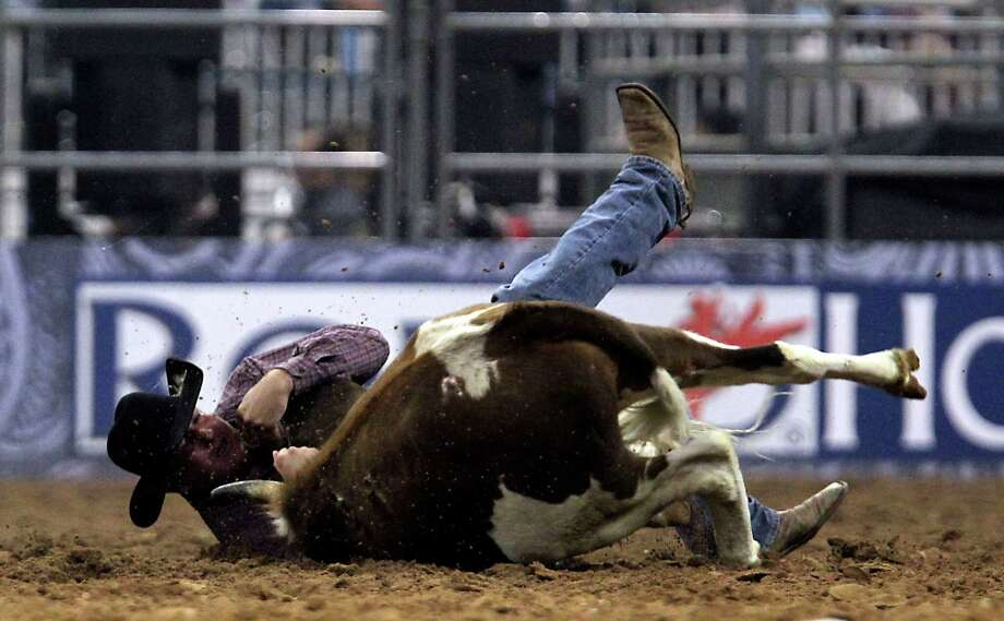 Tom Lewis competes during the Steer Wrestling event at RodeoHouston in Reliant Stadium Friday, March 15, 2013, in Houston. Photo: James Nielsen, Houston Chronicle / © 2013  Houston Chronicle