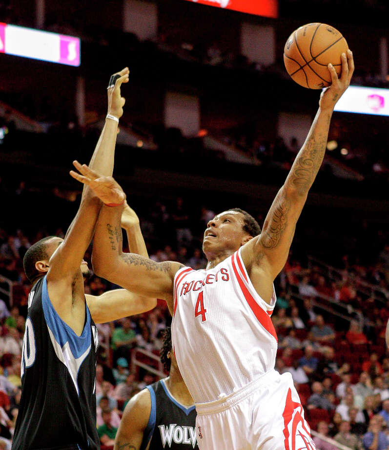 Greg Smith of the Rockets shoots over Chris Johnson of the Timberwolves. Photo: Bob Levey / ©2013 Bob Levey
