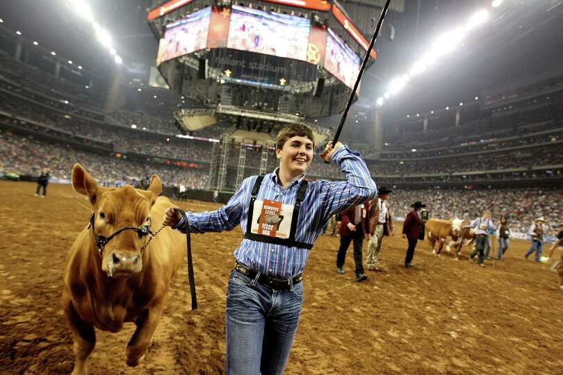 Kelton Long, of Wellington, waves to Stetson Copus, as he reacts after winning the Grand Champion St