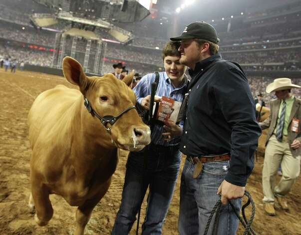 Kelton Long, of Wellington, gets a hug from Stetson Copus after winning the Grand Champion Steer of the Show with his steer Chappie at the Houston Livestock Show and Rodeo Friday, March 15, 2013, in Houston. Photo: Karen Warren, Houston Chronicle / © 2013 Houston Chronicle