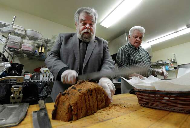 Chef Pat Hale cuts up some Irish soda bread before the St. Patrick's day celebration March 15, 2013,  Albany, N.Y.  With Hale is cooking volunteer Ron Guiry.  (Skip Dickstein/Times Union) Photo: SKIP DICKSTEIN