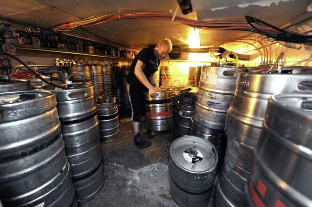 Bryan Niemiec stocks kegs in preperation for the St.Patrick's Day celebration at McGeary's on Friday March 15, 2013 in Albany, N.Y. (Michael P. Farrell/Times Union) Photo: Michael P. Farrell