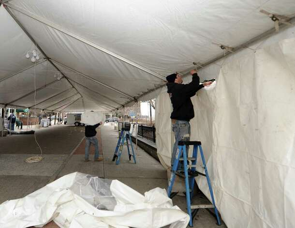 James Stock of Big Top Tent Rentals assembles a tent in preperation for the St.Patrick's Day celebration at McGeary's on Friday March 15, 2013 in Albany, N.Y. (Michael P. Farrell/Times Union) Photo: Michael P. Farrell