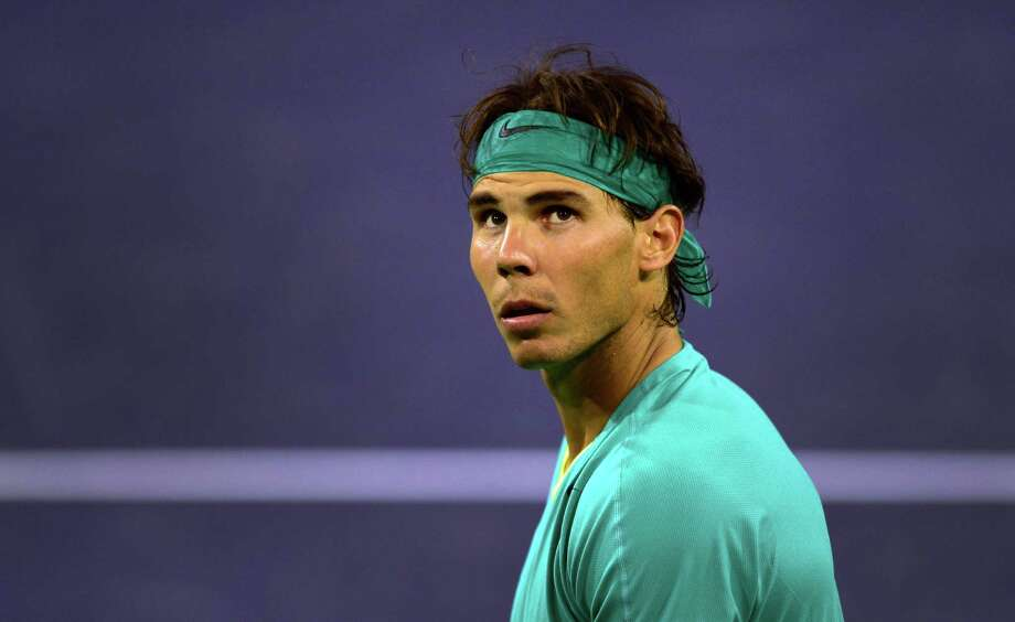 Rafael Nadal of Spain looks to a replay screen during the match against Ernests Gulbis of Lativa in their ATP fourth round match at the BNP Paribas Open in Indian Wells, California on March 13, 2013. AFP PHOTO/Frederic J. BROWNFREDERIC J. BROWN/AFP/Getty Images Photo: FREDERIC J. BROWN, Staff / AFP