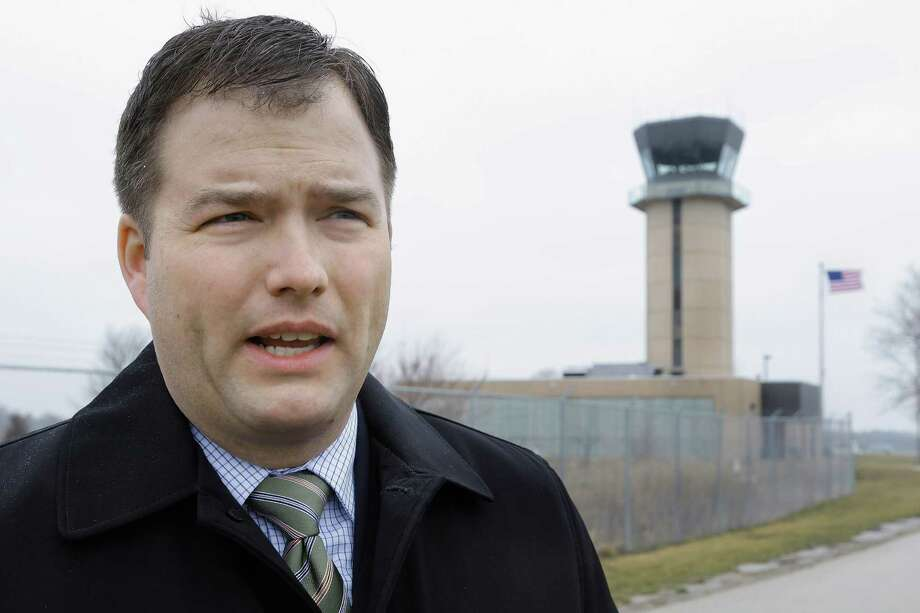 In this March 11, 2013 photo, Mark Hanna, director of the Abraham Lincoln Capital Airport in Springfield, Ill., talks about the possible closing of the air traffic control tower behind him and nearly 240 more around the country under federal budget cuts. Airport directors and pilots are concerned that eliminating a second pair of eyes on the ground will increase risk throughout the American air-transport system, the world's safest. (AP Photo/Seth Perlman) Photo: Seth Perlman