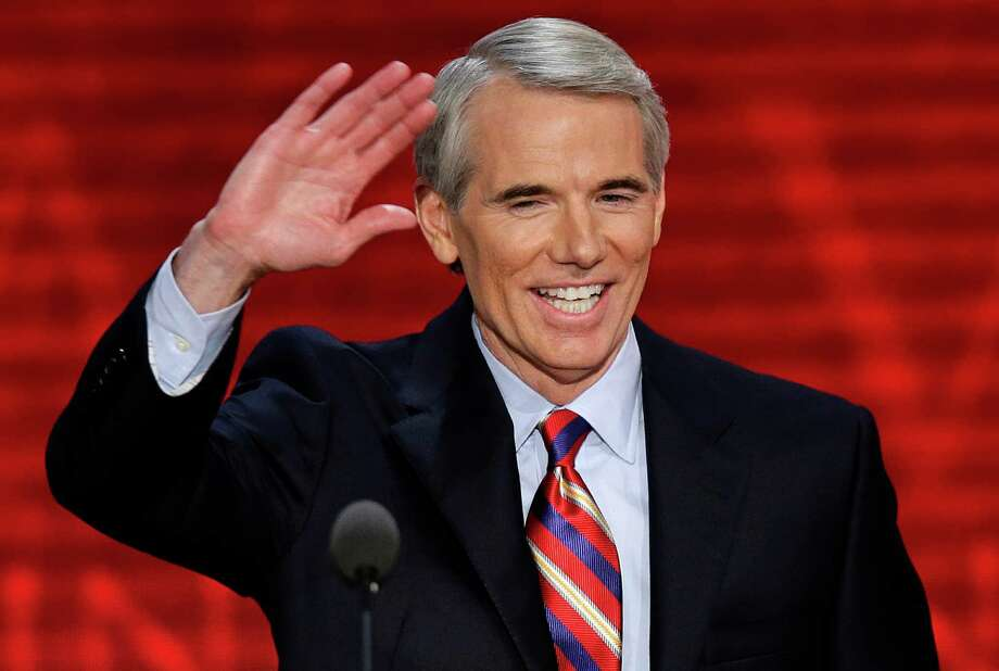 FILE - In this Aug. 29, 2012 file photo, Ohio Senator Rob Portman waves to the delegates during the Republican National Convention in Tampa, Fla. Portman said Thursday, March 14, 2013 that he now supports gay marriage and says his reversal on the issue began when he learned one of his sons is gay. (AP Photo/J. Scott Applewhite, File) Photo: J. Scott Applewhite