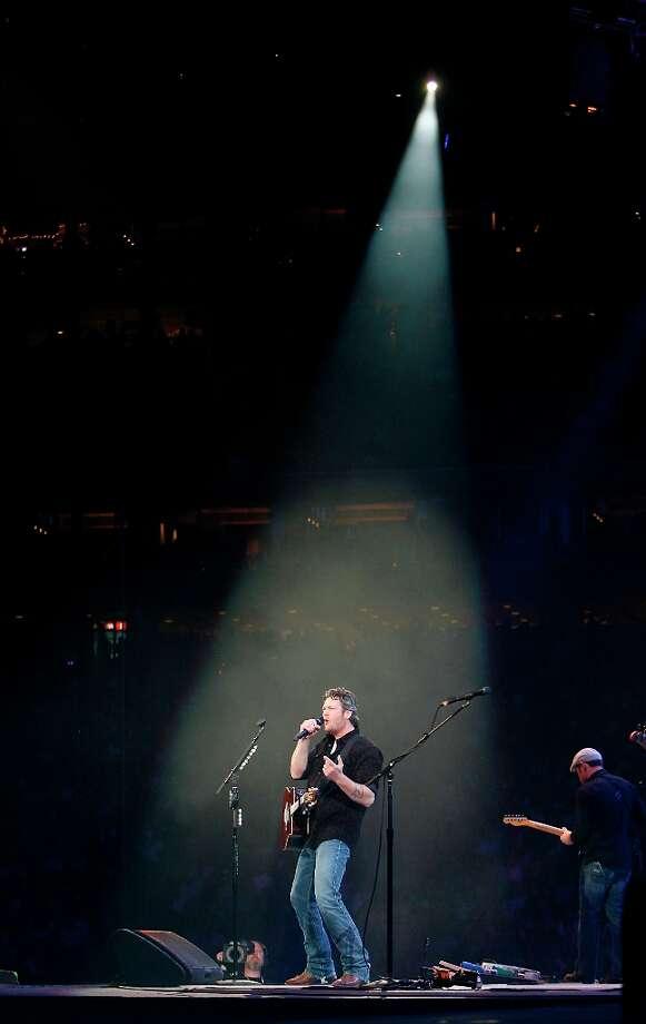 Blake Shelton performs in concert at RodeoHouston in Reliant Stadium Friday, March 15, 2013, in Houston.  Photo: James Nielsen, Houston Chronicle / © 2013  Houston Chronicle