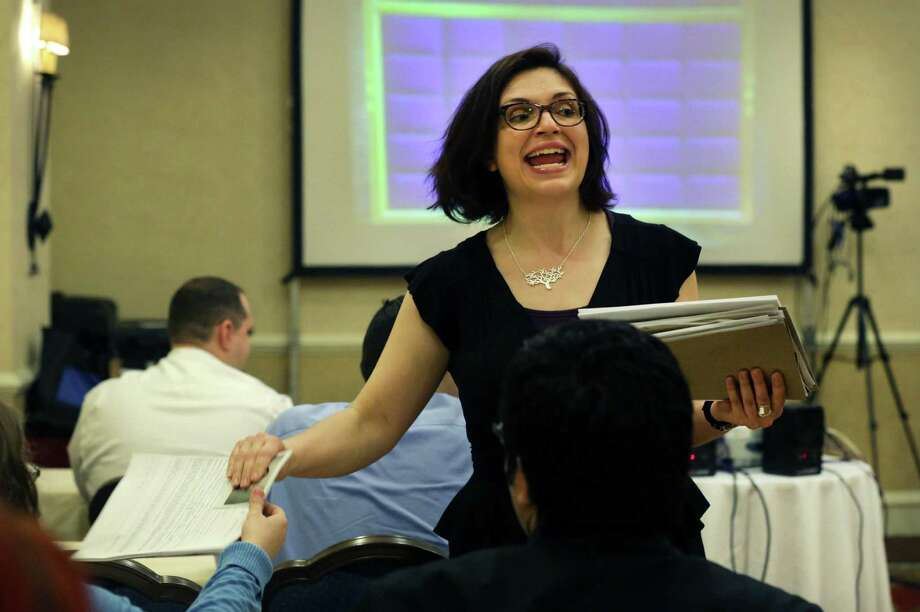 "One of the ""Jeopardy!"" coordinators, Corina Nusu, collects tests from potential contestants to be on the popular game show at the Westin Riverwalk hotel. Photo: Photos By Bob Owen / San Antonio Express-News"
