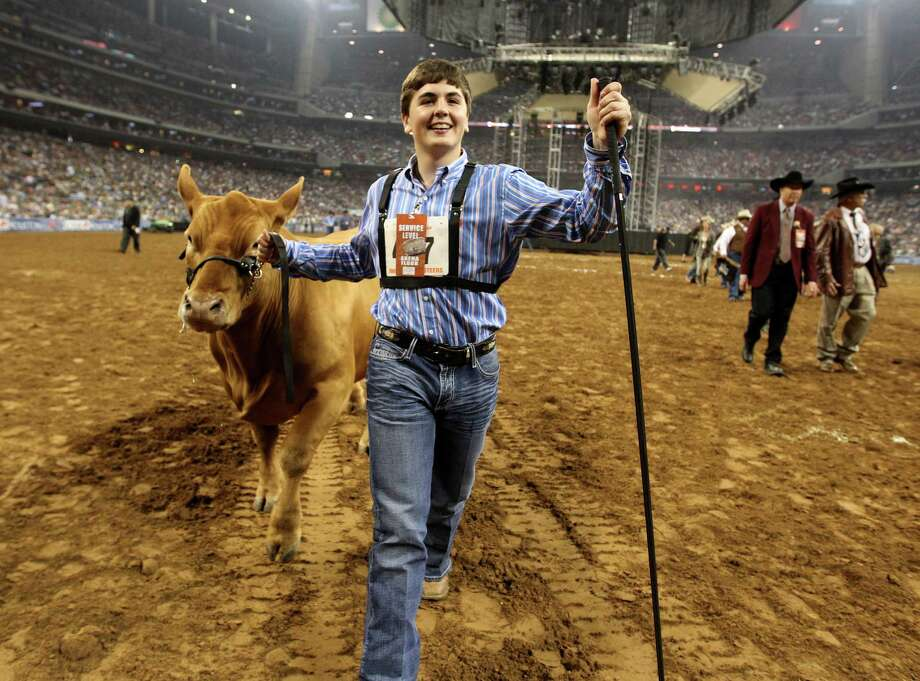 Kelton Long, of Wellington, reacts after winning the Grand Champion Steer of the Show with his steer at the Houston Livestock Show and Rodeo Friday, March 15, 2013, in Houston. ( Karen Warren / Houston Chronicle ) Photo: Karen Warren, Staff / © 2013 Houston Chronicle