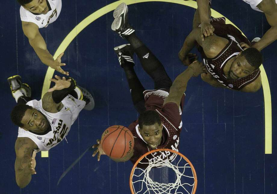 A&M's Ray Turner (center) and Kourtney Roberson vie for a rebound with Missouri's Alex Oriakhi. Photo: Mark Humphrey / Associated Press