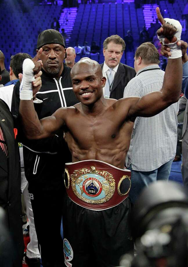 FILE - In this June 9, 2012 file photo, Timothy Bradley shows off his champion's belt following his split decision victory over Manny Pacquiao in a WBO welterweight title fight in Las Vegas. He drew criticism, ridicule and even death threats after his split decision over Pacquiao last year. Bradley is ready to start rebuilding his reputation against Russia's Ruslan Provodnikov on Saturday, March 16, 2013.  (AP Photo/Julie Jacobson, File) Photo: Julie Jacobson