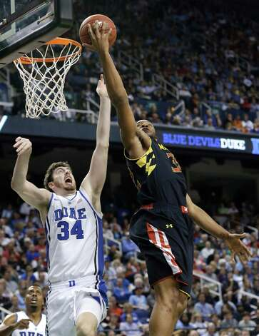 Maryland's Dez Wells, right, shoots over Duke's Ryan Kelly during the first half of an NCAA college basketball game at the Atlantic Coast Conference men's tournament in Greensboro, N.C., Friday, March 15, 2013. (AP Photo/Gerry Broome) Photo: Gerry Broome