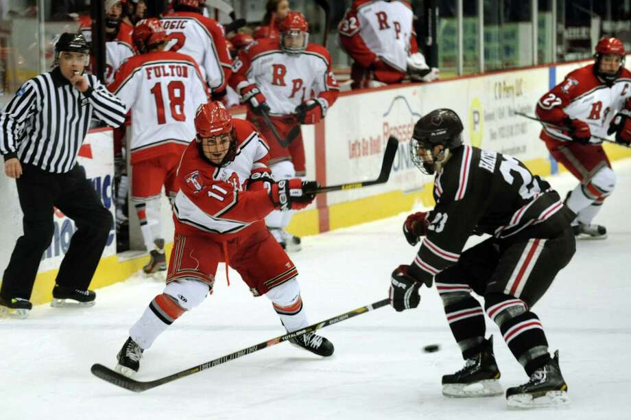 RPI's Bo Dolan, left, shoots the puck as Brown's Garnet Hathaway defends in the first game of their ECAC hockey series on Friday, March 15, 2013, at Rensselaer Polytechnic Institute in Troy, N.Y. Brown wins 3-1. (Cindy Schultz / Times Union) Photo: Cindy Schultz / 00021548A