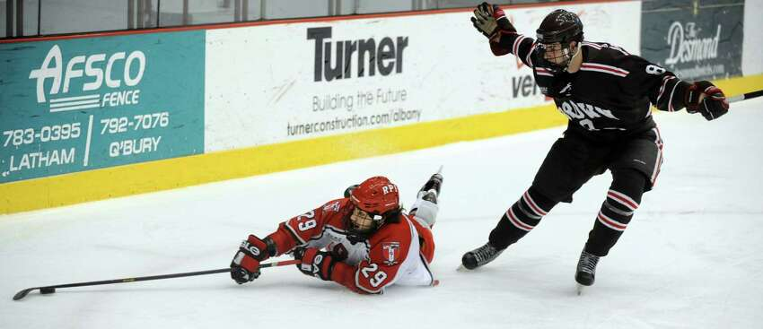 RPI's Nick Bailen, left, tries to maintain control of the puck as Brown's Joe Prescott defends in the first game of their ECAC hockey series on Friday, March 15, 2013, at Rensselaer Polytechnic Institute in Troy, N.Y. Brown wins 3-1. (Cindy Schultz / Times Union)