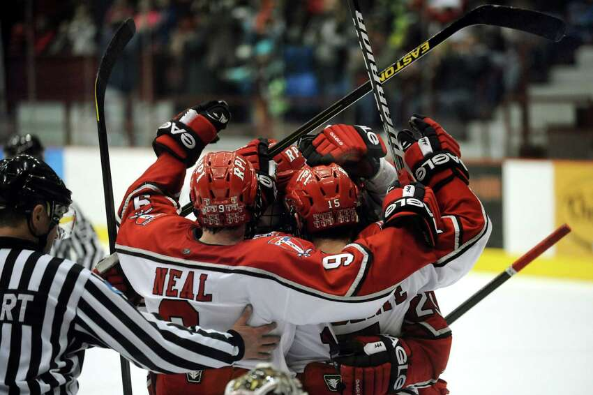 RPI celebrates a second-period goal by Jacob Laliberte (15), center, in the first game of their ECAC hockey series against Brown on Friday, March 15, 2013, at Rensselaer Polytechnic Institute in Troy, N.Y. It was their only goal and Brown wins 3-1. (Cindy Schultz / Times Union)