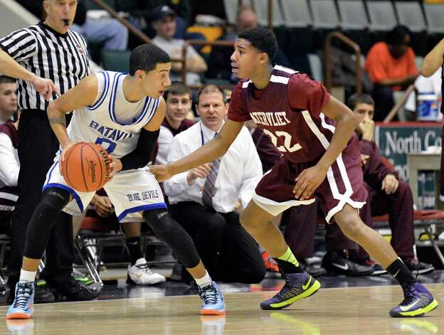 Watervliet's #22 Henassy McConico, at right, guards Batavia's #0 Jalen Smith as Vliet coach Orlando DiBacco, center, looks on during the Class B semifinal at Glens Falls Civic Center Friday March 15, 2013.  (John Carl D'Annibale / Times Union) Photo: John Carl D'Annibale