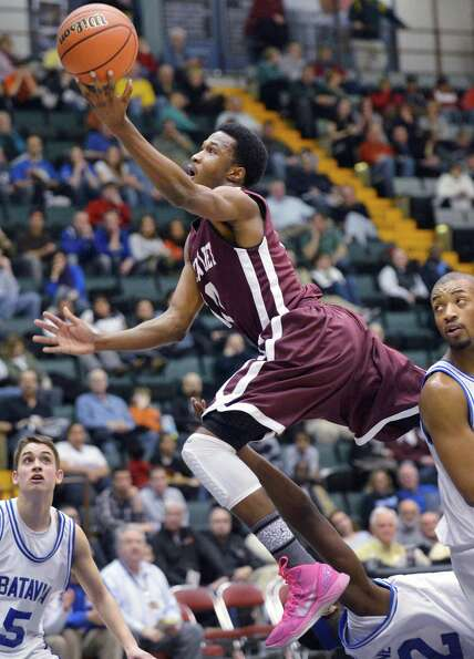 Watervliet's #10 Tyler McLeod drives to the basket against Batavia in the Class B semifinal at Glens