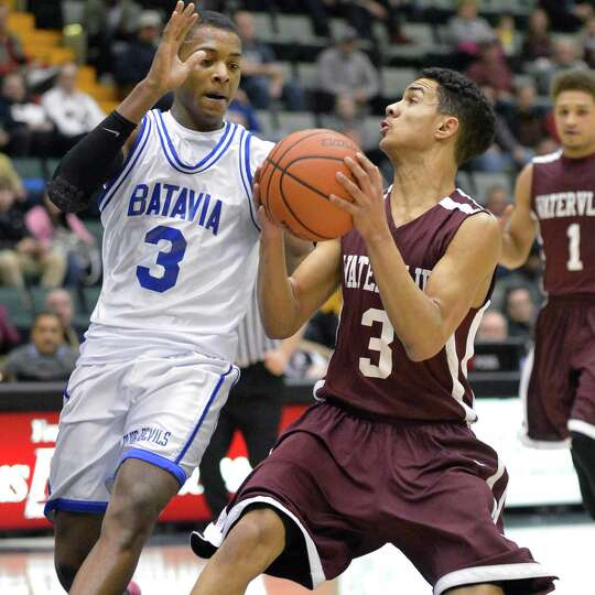 Watervliet's #3 Ty'Jon Gilmore and Batavia's #3 Tajzay Powell during the Class B semifinal at Glens