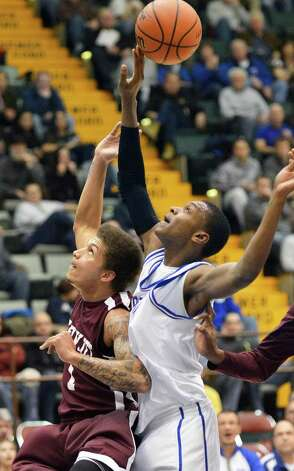 Watervliet's #1 Jordan Gleason, left, and Batavia's #0 Jalen Smith during the Class B semifinal at Glens Falls Civic Center Friday March 15, 2013.  (John Carl D'Annibale / Times Union) Photo: John Carl D'Annibale