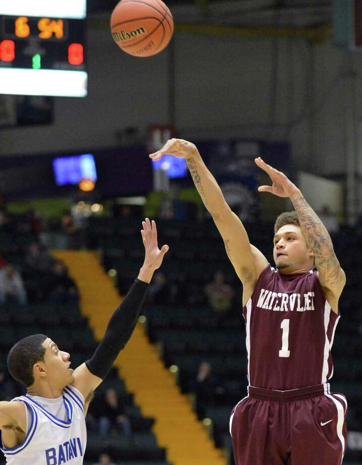 Watervliet's #1 Jordan Gleason sinks a three pointer against Batavia's #0 Jalen Smith during the Class B semifinal at Glens Falls Civic Center Friday March 15, 2013.  (John Carl D'Annibale / Times Union) Photo: John Carl D'Annibale