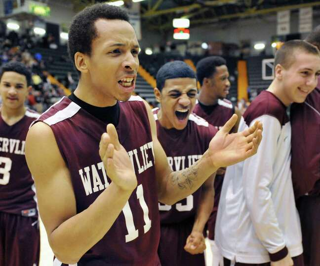 Watervliet;s #11 Shane Ray and #33 Shylatron Copeland, center react to their win over Batavia in the