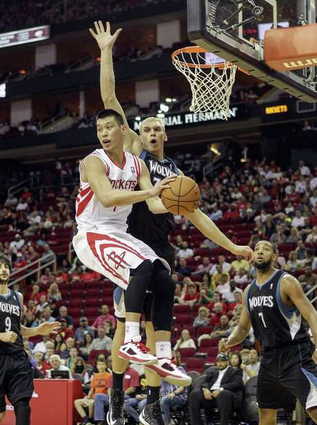 Rockets guard Jeremy Lin (left) looks to pass to a teammate as Timberwolves center Greg Stiemsma applies defensive pressure in the second half. Photo: Bob Levey / Houston Chronicle